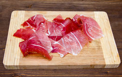 Ham on cutting board on wood Stock Images