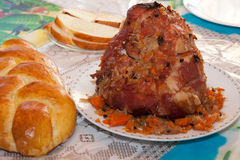 Ham dinner. A delicious looking ham served with homemade bread Stock Images