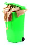 Ham in dustbin. Symbolizing the throwaway culture Royalty Free Stock Photography