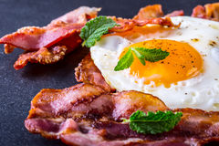 Ham and Egg. Bacon and Egg. Salted egg and sprinkled with black pepper and green herb decoration. Stock Images