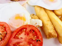 Ham, egg and chips with grilled tomato Stock Images