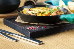 Ham and egg omelette, bio eggs, fresh herbs stock photos