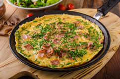 Ham and egg omelette stock images