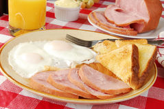 Ham and eggs. Ham and fried eggs with toast Stock Images