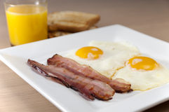 Ham and Eggs. Typical breakfast with fried ham and eggs Stock Photos