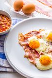 Ham and Eggs. Bacon and Eggs. Salted egg and sprinkled with red pepper. English breakfast.  Stock Photo