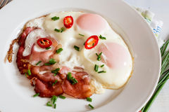 Ham and eggs with chili Stock Photos