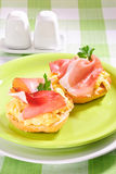Ham and eggs sandwich. Ham and scrambled eggs sandwich on a plate Royalty Free Stock Images