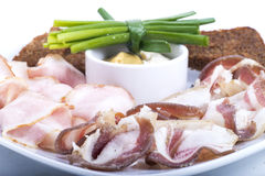 Ham fat. Fat and ham on a white dish close up with mustard Royalty Free Stock Photography