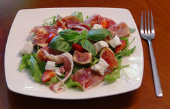 Ham with figs and rucola stock image