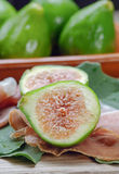 Ham and figs Stock Photos