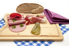 Ham and gherkin with salamis Stock Images
