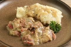 Ham hock in cider sauce Royalty Free Stock Photography