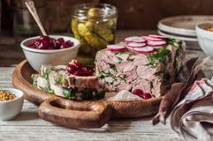 Ham Hock Terrine. Sliced Ham Hock Jelly Terrine with Pickles and Cranberry Sauce royalty free stock image