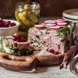 Ham Hock Terrine. Sliced Ham Hock Jelly Terrine with Pickles and Cranberry Sauce, square royalty free stock photos