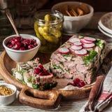 Ham Hock Terrine. Sliced Ham Hock Jelly Terrine with Pickles and Cranberry Sauce, square stock photos