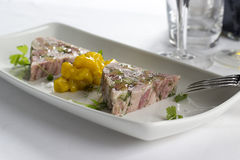 Ham hock & trotter terrine with piccalilli Stock Image