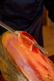 Ham, jamon iberico being cutted Stock Image