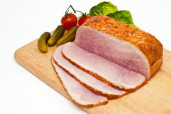 Ham joint on a wooden cutting borad Royalty Free Stock Image
