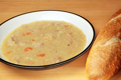Ham and lentil soup. Soup made with red lentils, carrots, onion and ham Royalty Free Stock Image