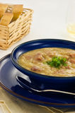 Ham and Lentil soup. In blue bowl, vertical format Royalty Free Stock Image