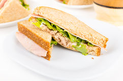 Ham and lettuce sandwich on a white plate Royalty Free Stock Photo