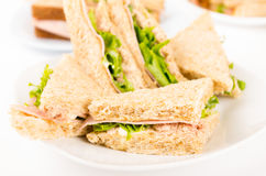Ham and lettuce sandwich on a white plate Stock Photo