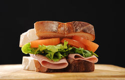 Ham, Lettuce and tomato sandwich. Made with thick white bread, shot on a wooden table stock image