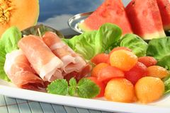 Ham with melon Stock Photos