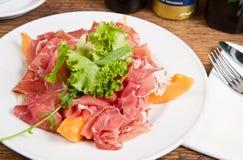 Ham with melon Stock Image