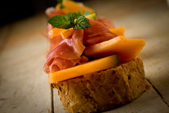 Ham and melon appetizer Royalty Free Stock Images