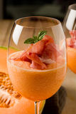 Ham and Melon Cocktail. Photo of delicious ham and melon cocktail appetizer on wooden table stock photo