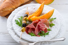 Ham with melon and olives Stock Image