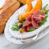 Ham with melon and olives Royalty Free Stock Photography
