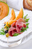 Ham with melon and olives Royalty Free Stock Images