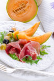 Ham with melon and olives Royalty Free Stock Photos