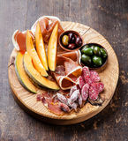 Ham, melon and olives Royalty Free Stock Photos