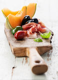 Ham, melon and Olives Stock Photo