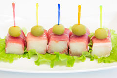Ham with a melon and olives Stock Images