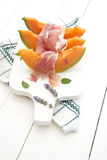 Ham and melon. Presentation of some slices of melon with ham on white-border Stock Images