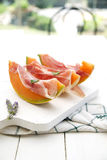Ham and melon Stock Images