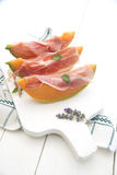 Ham and melon. Presentation of some slices of melon with ham on white-border Royalty Free Stock Images