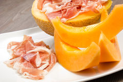 Ham and melon on the white dish Royalty Free Stock Photography