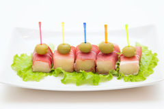 Ham met een meloen en olijven Royalty-vrije Stock Foto's