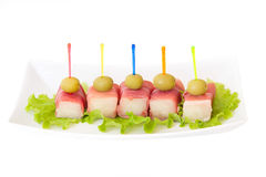 Ham met een meloen en olijven Stock Fotografie