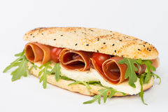 Ham, Mozzarella and Arugula Sandwich. Seeded roll with cured ham, mozzarella cheese and arugula greens royalty free stock photos