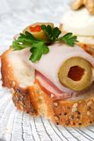 Ham and olive canape. Delicious ham and stuffed olive canape ready to eat royalty free stock image