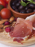 Ham with  olive oil on the wooden  board. Ham with  black olive  on the wooden  table Royalty Free Stock Image