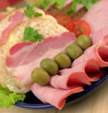 Ham with olives. Smoked Ham slices on plate close-up stock photo