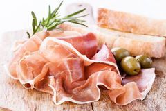 Ham with olives Stock Images